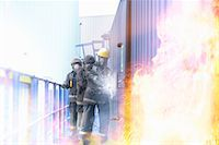Firefighters in simulation training Stock Photo - Premium Royalty-Freenull, Code: 649-06622766