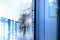 Firefighters in simulation training Stock Photo - Premium Royalty-Freenull, Code: 649-06622767
