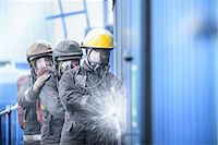 Firefighters in simulation training Stock Photo - Premium Royalty-Freenull, Code: 649-06622768