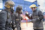 Firefighters in simulation training Stock Photo - Premium Royalty-Freenull, Code: 649-06622771
