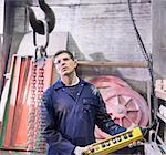 Worker using equipment in foundry Stock Photo - Premium Royalty-Free, Artist: Blend Images, Code: 649-06622801