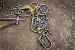 Metal chain on dirt floor Stock Photo - Premium Royalty-Free, Artist: Blend Images, Code: 649-06622803