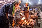 Workers pouring molten metal in foundry Stock Photo - Premium Royalty-Free, Artist: Blend Images, Code: 649-06622812