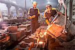Workers pouring molten metal in foundry Stock Photo - Premium Royalty-Free, Artist: Ikon Images, Code: 649-06622813