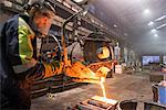 Worker pouring molten metal in foundry Stock Photo - Premium Royalty-Free, Artist: ableimages, Code: 649-06622816