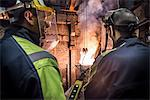 Workers talking in metal foundry Stock Photo - Premium Royalty-Free, Artist: GreatStock, Code: 649-06622825
