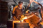 Worker pouring molten metal in foundry Stock Photo - Premium Royalty-Free, Artist: Blend Images, Code: 649-06622827