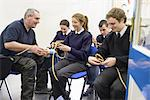 Teacher demonstrating nautical knots Stock Photo - Premium Royalty-Free, Artist: Cultura RM, Code: 649-06622842