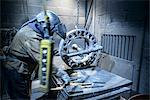 Worker preparing to cut metal in foundry Stock Photo - Premium Royalty-Free, Artist: Blend Images, Code: 649-06622849