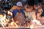 Worker curing mould in foundry Stock Photo - Premium Royalty-Free, Artist: Blend Images, Code: 649-06622857
