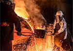 Worker pouring molten metal in foundry Stock Photo - Premium Royalty-Free, Artist: Uwe Umstätter, Code: 649-06622860