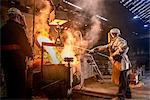 Worker pouring molten metal in foundry Stock Photo - Premium Royalty-Free, Artist: Robert Harding Images, Code: 649-06622861