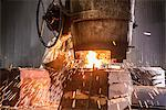 Worker pouring molten metal in foundry Stock Photo - Premium Royalty-Free, Artist: Blend Images, Code: 649-06622863