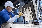 Worker coating mould in metal foundry Stock Photo - Premium Royalty-Free, Artist: Water Rights, Code: 649-06622866