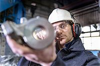 Worker inspecting metal in foundry Stock Photo - Premium Royalty-Freenull, Code: 649-06622872