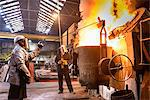Workers pouring molten metal in factory Stock Photo - Premium Royalty-Free, Artist: Cultura RM, Code: 649-06622878