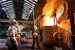 Workers pouring molten metal in factory Stock Photo - Premium Royalty-Free, Artist: R. Ian Lloyd, Code: 649-06622879