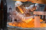 Workers cleaning metal flask in factory Stock Photo - Premium Royalty-Free, Artist: Cultura RM, Code: 649-06622884