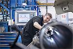 Worker using machinery in factory Stock Photo - Premium Royalty-Free, Artist: Blend Images, Code: 649-06622929