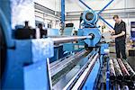 Worker using machinery in factory Stock Photo - Premium Royalty-Free, Artist: Blend Images, Code: 649-06622939