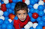 Boy playing in ball pit Stock Photo - Premium Royalty-Free, Artist: Martin Ruegner, Code: 649-06623023