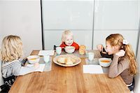 family table eating together - Children eating lunch at table Stock Photo - Premium Royalty-Freenull, Code: 649-06623057