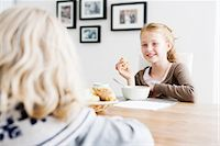 family table eating together - Girls eating lunch at table together Stock Photo - Premium Royalty-Freenull, Code: 649-06623060