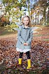Girl wearing fairy wings in park Stock Photo - Premium Royalty-Freenull, Code: 649-06623085