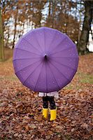 Girl playing with umbrella in park Stock Photo - Premium Royalty-Freenull, Code: 649-06623087