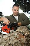 Man sawing log Stock Photo - Premium Rights-Managed, Artist: F1Online, Code: 853-06623200
