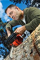forestry - Man sawing log Stock Photo - Premium Rights-Managednull, Code: 853-06623201