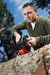 Man sawing log Stock Photo - Premium Rights-Managed, Artist: F1Online, Code: 853-06623202