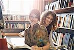 Students with books smiling in library Stock Photo - Premium Royalty-Free, Artist: Blend Images, Code: 614-06623344