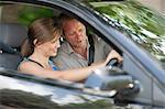 Father teaching teenage daughter driving Stock Photo - Premium Royalty-Free, Artist: Blend Images, Code: 614-06623403