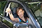 Teenage girl holding keys to new car Stock Photo - Premium Royalty-Free, Artist: ableimages, Code: 614-06623410