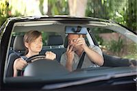 Father teaching teenage daughter driving Stock Photo - Premium Royalty-Freenull, Code: 614-06623420