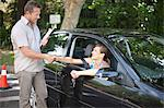 Driving instructor congratulating student Stock Photo - Premium Royalty-Free, Artist: ableimages, Code: 614-06623428