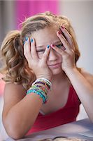preteen girl pigtails - Frustrated girl with head in hands Stock Photo - Premium Royalty-Freenull, Code: 614-06623440