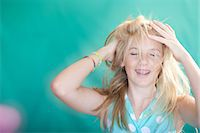 preteen open mouth - Teenage girl tossing her hair Stock Photo - Premium Royalty-Freenull, Code: 614-06623451