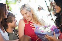 Family smiling at mother Stock Photo - Premium Royalty-Freenull, Code: 614-06623496