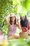 Women picnicking together in park Stock Photo - Premium Royalty-Free, Artist: Cultura RM, Code: 614-06623592