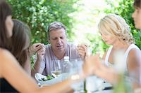 Family saying grace before eating Stock Photo - Premium Royalty-Freenull, Code: 614-06623604