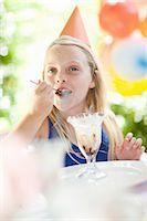 Girl having ice cream sundae at party Stock Photo - Premium Royalty-Freenull, Code: 614-06623764