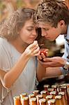 Couple tasting preserves in grocery Stock Photo - Premium Royalty-Free, Artist: Cultura RM, Code: 614-06623814