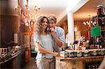 Couple tasting olives in grocery Stock Photo - Premium Royalty-Free, Artist: Blend Images, Code: 614-06623826