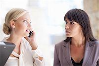 Businesswomen standing outdoors Stock Photo - Premium Royalty-Freenull, Code: 614-06623836