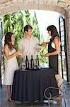 Couple tasting wine in doorway Stock Photo - Premium Royalty-Free, Artist: Cultura RM, Code: 614-06623877