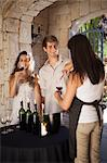 Couple tasting wine in doorway Stock Photo - Premium Royalty-Free, Artist: Ikonica, Code: 614-06623886