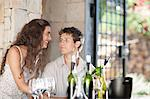 Couple tasting wine in doorway Stock Photo - Premium Royalty-Free, Artist: Cultura RM, Code: 614-06623892