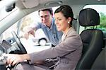 Salesman showing woman new car Stock Photo - Premium Royalty-Free, Artist: Blend Images, Code: 614-06623952